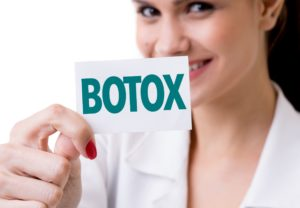 woman holding Botox card