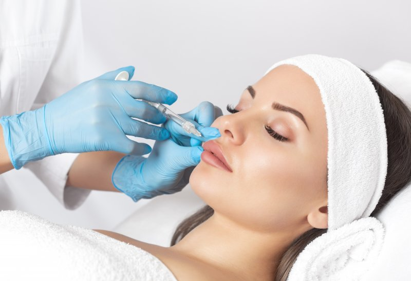 a female patient receiving cosmetic fillers in Ocala